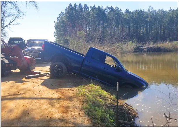 Woman Swims to Safety  As Truck Plunges into Pond